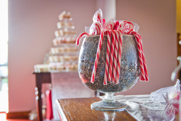 Wedding reception sweets cart table. Candy canes