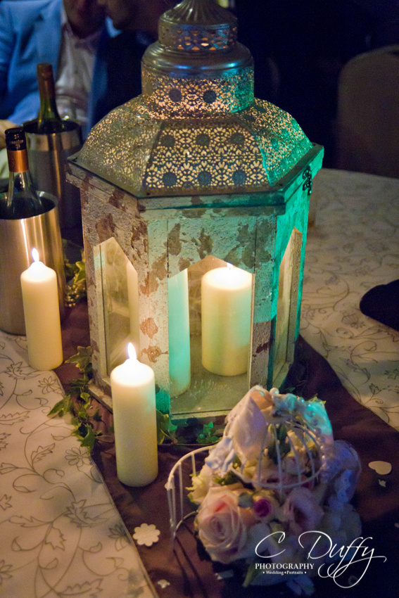 Vintage lantern and candle table centre piece decoration for wedding reception